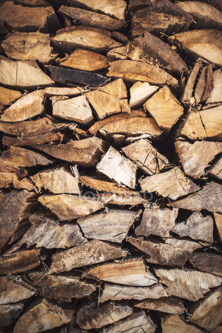 Chopped firewood logs in pile — Stock Photo