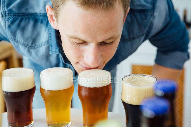 Man smelling craft beer — Stock Photo