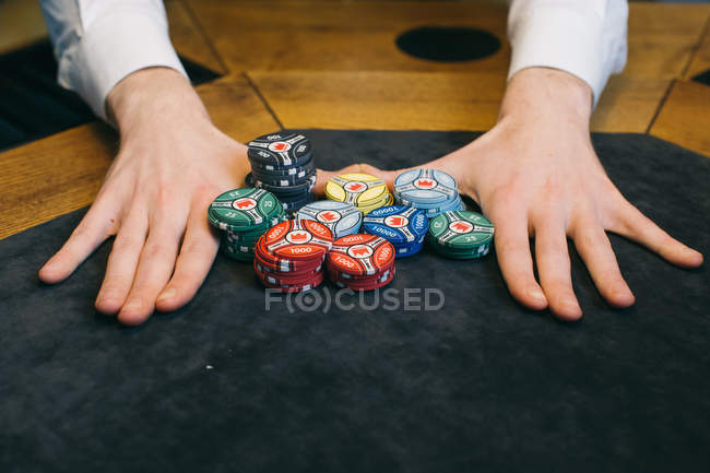 Poker player with chips — Stock Photo