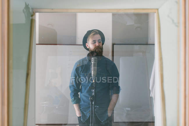 Young man in studio — Stock Photo