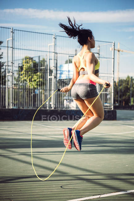 Woman doing skipping workou — Stock Photo