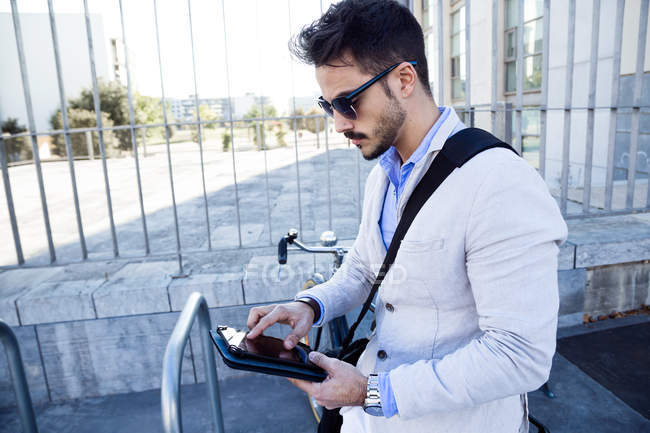 Young businessman using digital tablet — Stock Photo