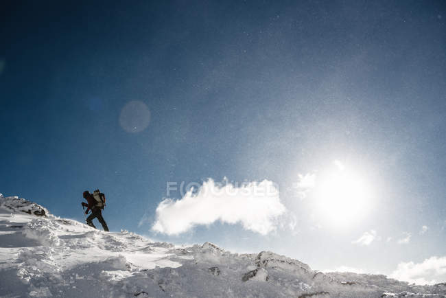 Climber on top of snowy mountain — Stock Photo