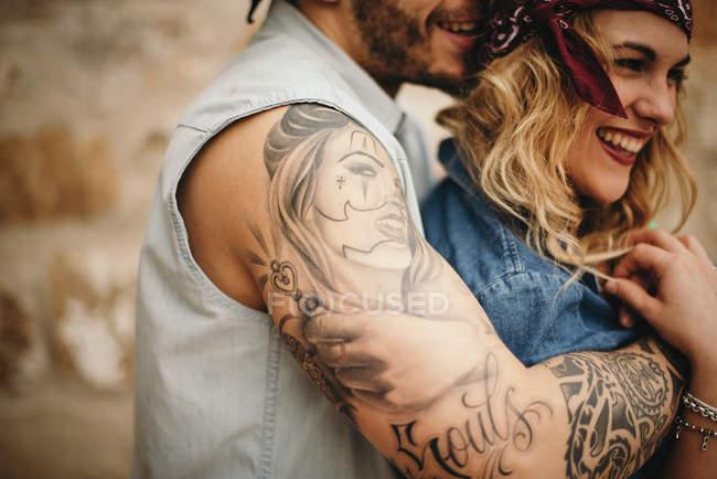 Boyfriend embracing his smiling girlfriend — Stock Photo