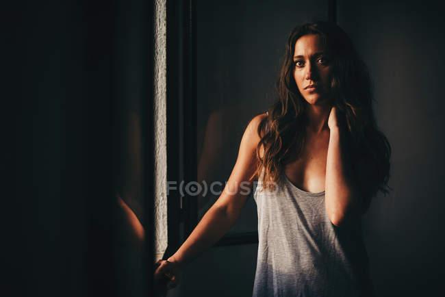 Beautiful woman in grey — Stock Photo