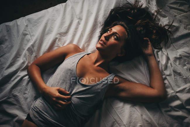 Beautiful woman in grey top — Stock Photo
