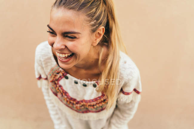 Laughing young blonde woman — Stock Photo