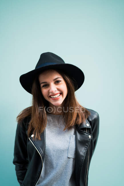 Smiling woman wearing hat — Stock Photo