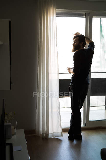 Bearded man drinking wine — Stock Photo