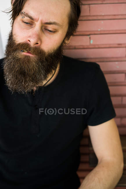 Tough bearded man with serious expression — Stock Photo