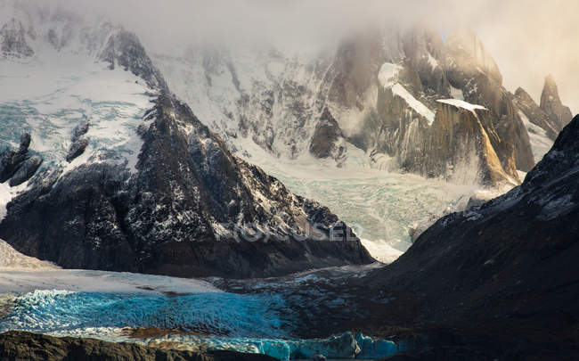 Snowy mountain formation in sunlight — Stock Photo
