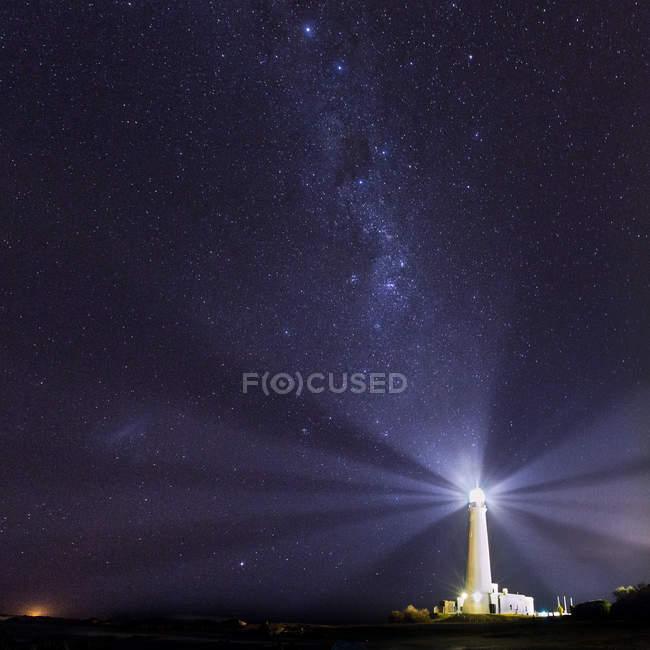 Lighthouse burning in night — Stock Photo