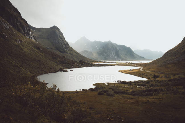 Valley with lake in mountains — Stock Photo