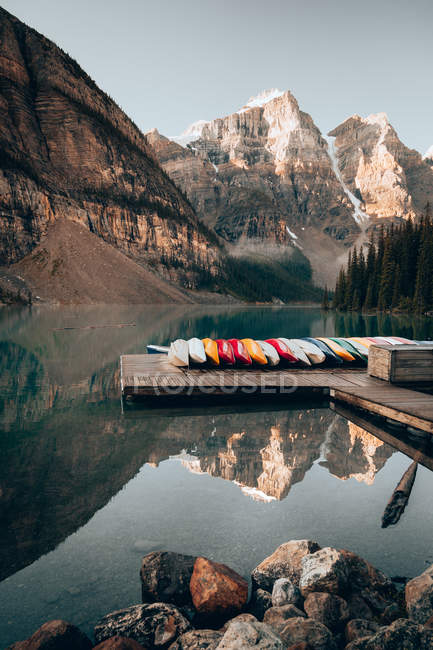 Pier with boats in mountains. — Stock Photo