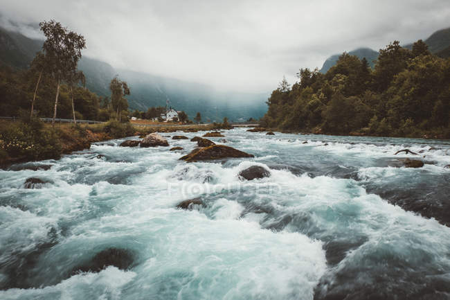 Fast mountain river in gloomy day — Stock Photo