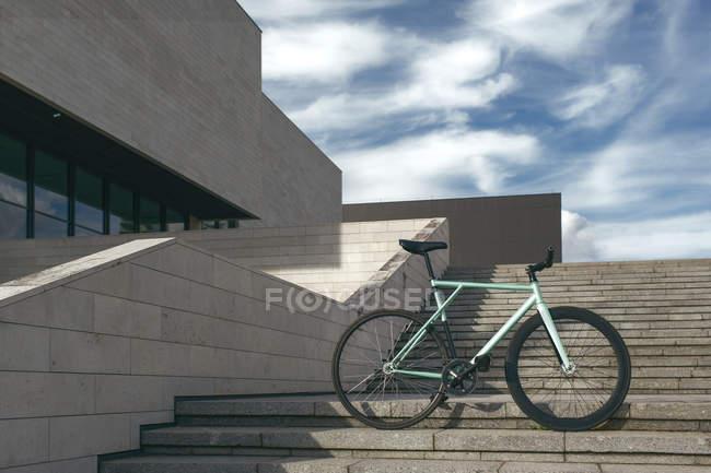 Modern bike on steps — Stock Photo
