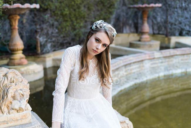 Gentle female posing in bridal dress — Stock Photo
