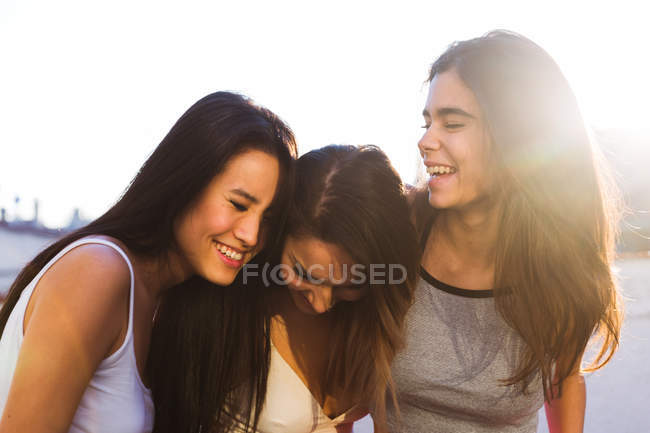 Three women laughing — Stock Photo