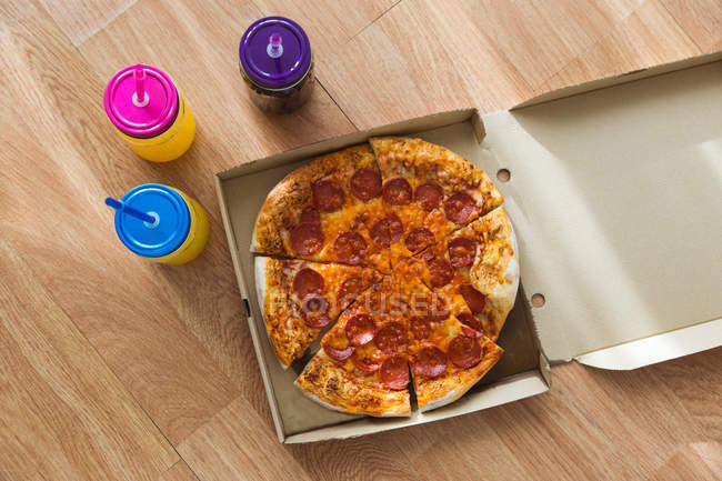 Pizza and three jars with drink — Stock Photo