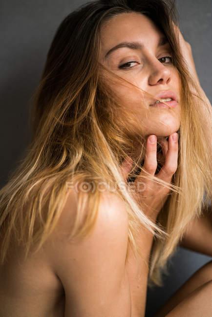 Sensual woman touching chin — Stock Photo