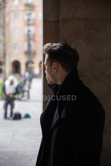 Man wearing black outfit and turning away — Stock Photo