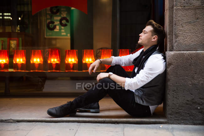 Man sitting on ground and looking away — Stock Photo