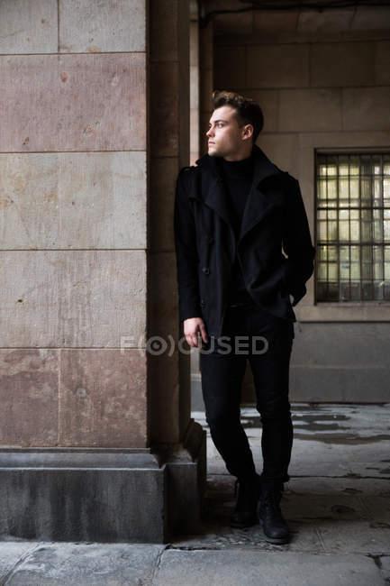 Stylish man standing in black — Stock Photo