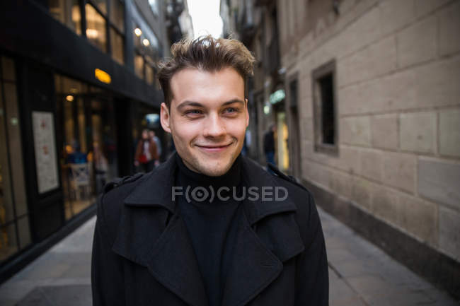 Young happy man in street — Stock Photo