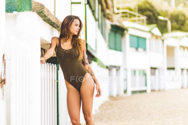 Woman with long hair in swimsuit — Stock Photo