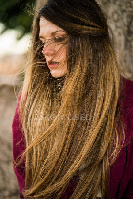 Thoughtful woman looking down — Stock Photo