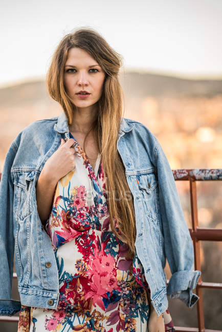 Young female posing in jeans jacket — Stock Photo