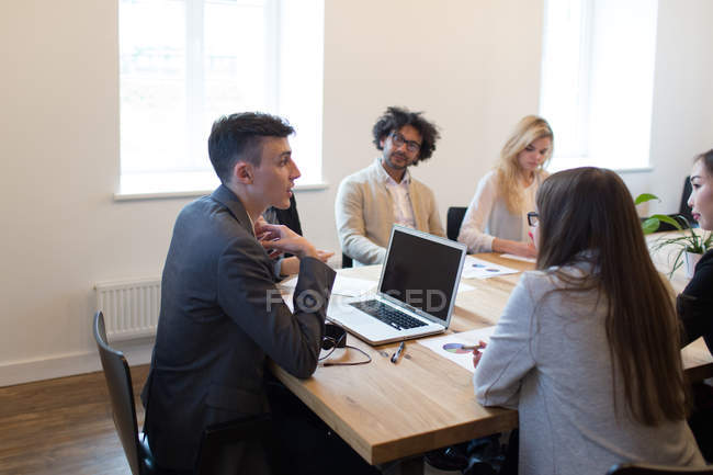 Young colleagues at meeting in modern office — Stock Photo