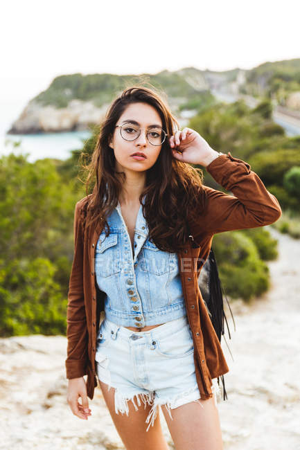Girl in eyeglasses looking at camera — Stock Photo