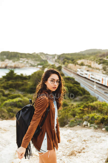 Girl looking over shoulder at camera — Stock Photo