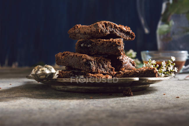 Pile of brownie bars on metal plate — Stock Photo