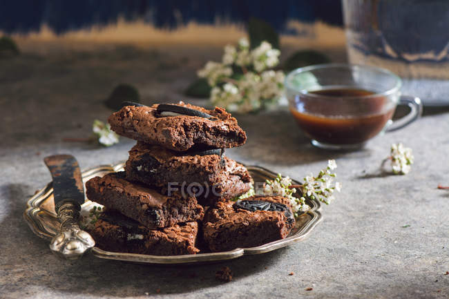 Metal plate with pile of brownies — Stock Photo