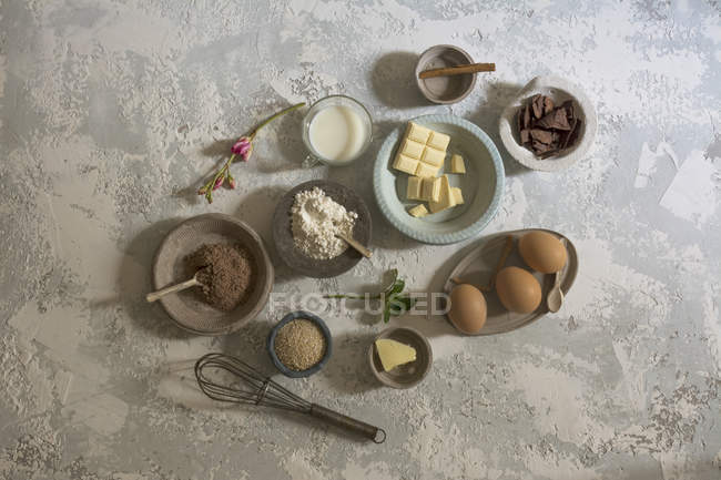 Directly above view sweet ingredients arranged on stone table — Stock Photo