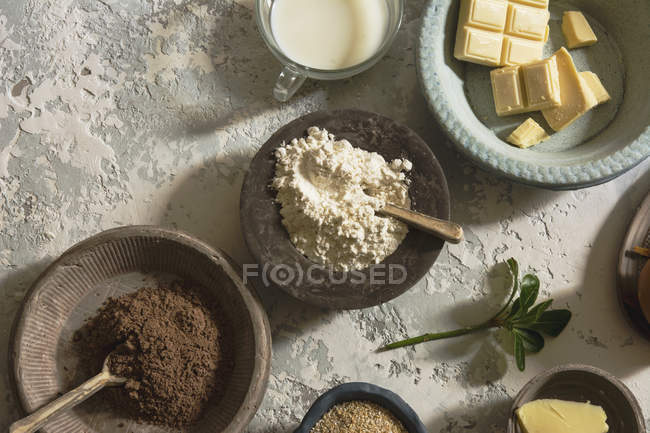 Directly above view of bowls with ingredients arranged on stone table — Stock Photo
