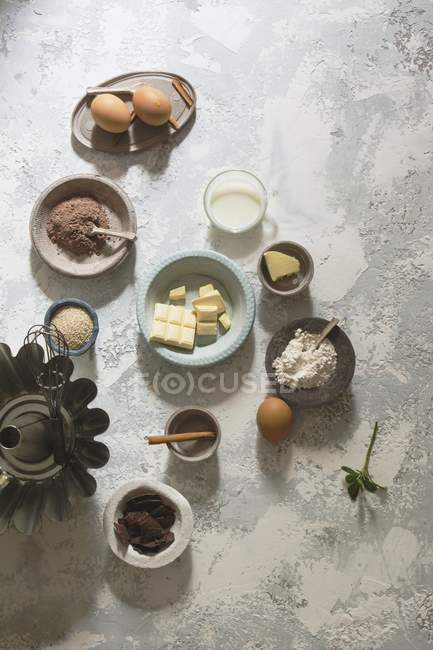 Arrangement of baking ingredients on stone table — Stock Photo