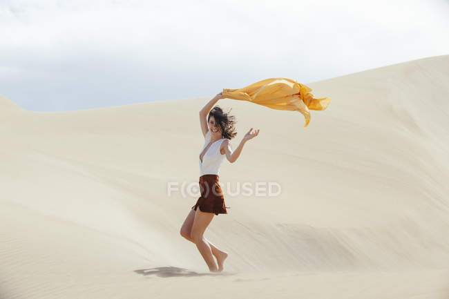 Woman in sand dunes — Stock Photo