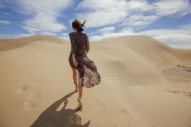 Woman in summer outfit in dunes — Stock Photo
