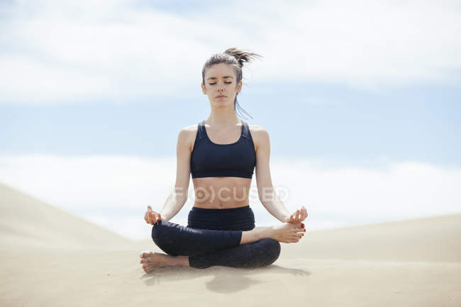 Peaceful woman in yoga pose — Stock Photo