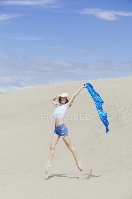Cheerful girl jumping — Stock Photo