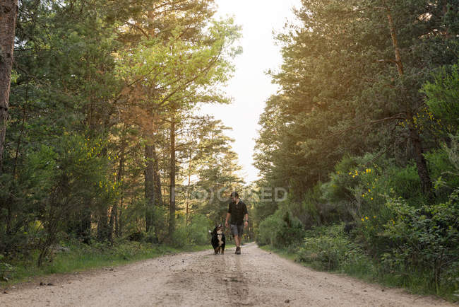 Man with his dog in forest — Stock Photo