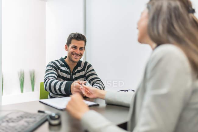 Man signing document in office — Stock Photo