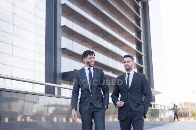 Businessmen walking in business area. — Stock Photo