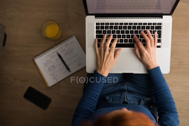 Woman at work from above — Stock Photo