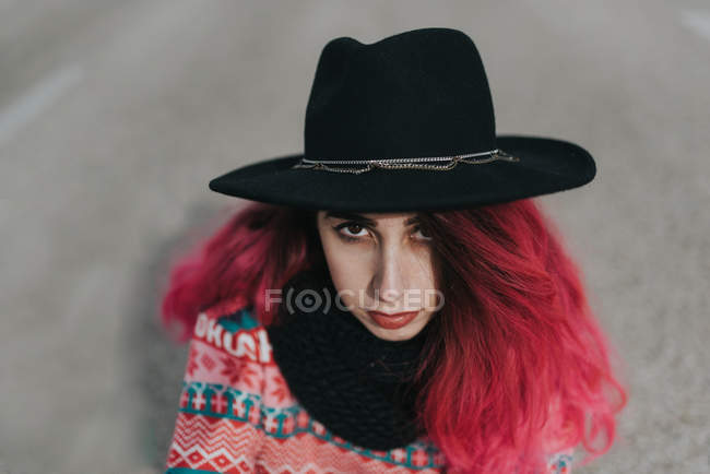 Girl with pink hair in hat — Stock Photo