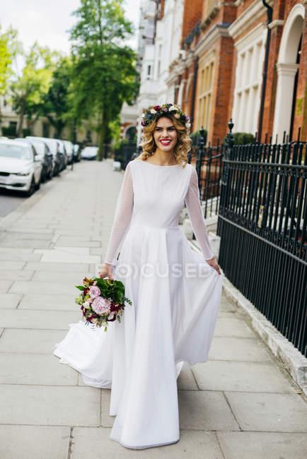 Gorgeous bride in street — Stock Photo