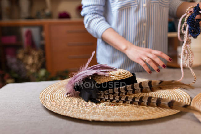 Crop person working in craft shop — Stock Photo